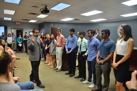 Coppell High School Principal Mike Jasso recognizes all 36 of the Coppell High School National Merit finalists on Monday at the Vonita White Administration Building. This is a record number of National Merit finalists for the history of Coppell High School. Photo by Jennifer Su.