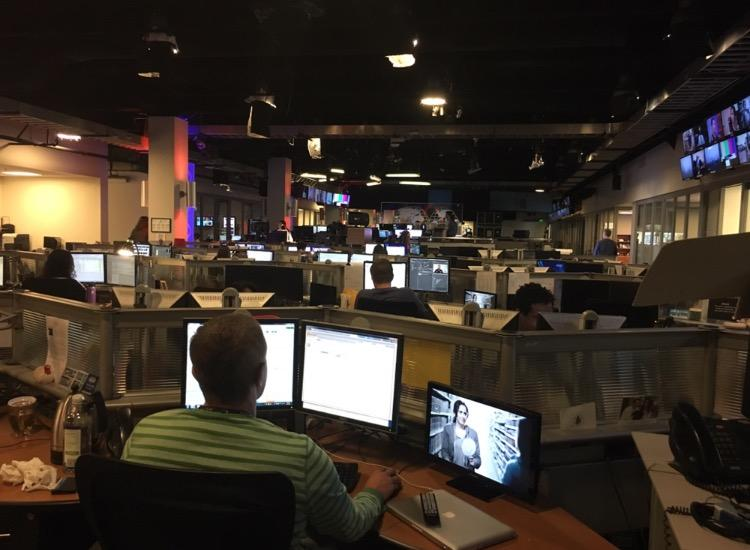 The CBS newsroom reporters all work on their stories as members of Coppell Student Media are given a tour around the CBS Studios Center in Los Angeles on Thursday. Members of The Sidekick and KCBY were able to talk with many different journalists and learn about the professional news company.