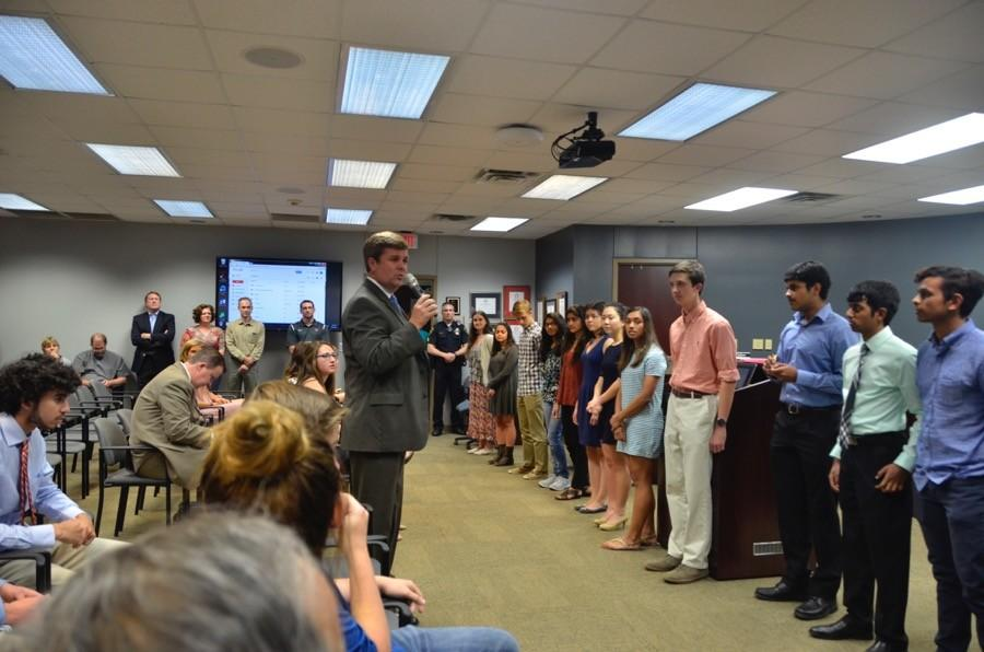 Coppell Independent School District school board president David Apple congratulates the Coppell High School National Merit finalists on their hard work on Monday at the Vonita White Administration Building. This is a record number of National Merit finalists for the history of Coppell High School.