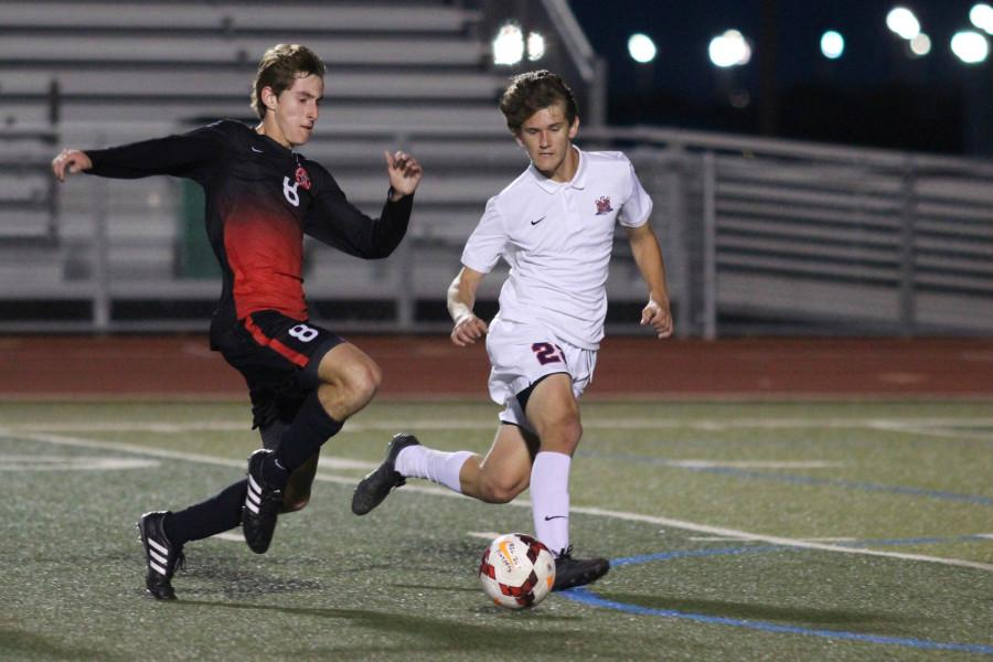 Coppell+High+School+senior+and+midfielder+Scott+Simigian+attempts+to+steal+the+ball+from+a+McKinney+Boyd+forward+as+the+second+half+of+Tuesday+night%27s+game+begins.+The+Coppell+Cowboys+ended+the+night+with+a+4-1+victory+over+the+McKinney+Boyd+Broncos+at+the+Frisco+Memorial+Stadium.