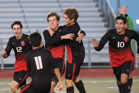 After Coppell's third goal of the night is scored by Coppell High School junior Nick Taylor, the Cowboys celebrate as the second half of Tuesday night's game begins. The Coppell Cowboys defeated the McKinney Boyd Broncos 4-1, resulting in their advancement to regional semifinals.