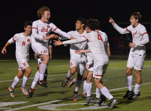 The Coppell Cowboys soccer team celebrates junior Parker Mcclure's goal during the second half of their 6A state championship match on Saturday night at Birkelbach Field in Georgetown to make the score 3-1. The Cowboys defeated Lake Travis, 6-1, in the state championship match, ending their undefeated season with a record of 24-0-2.