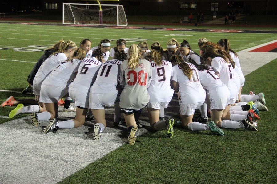 Coppell High School varsity soccer team prays before the second round of the playoffs.The Cowgirls lost to the Lady Eagles on Friday night at Buddy Echols Field with a score of 2-3.