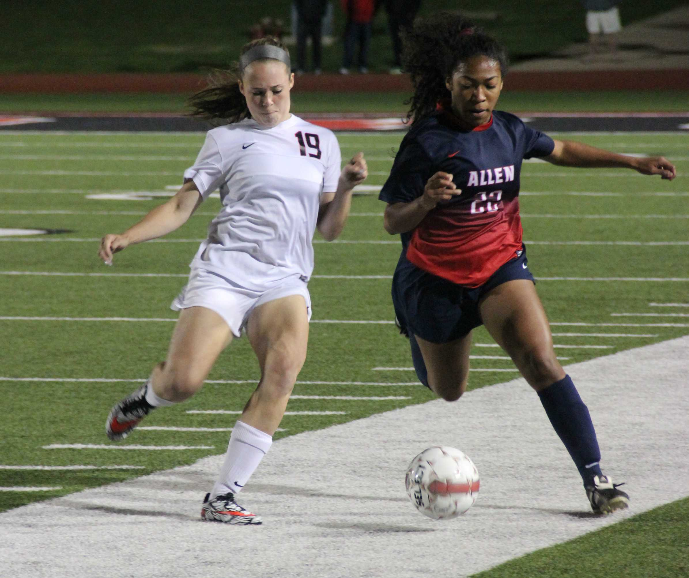 Coppell High School junior Baylee Hux tries to keep the ball from Allen player during the first half. The Cowgirls lost to the Lady Eagles on Friday night at Buddy Echols Field with a final score of 2-3. Photo by Megan Winkle.