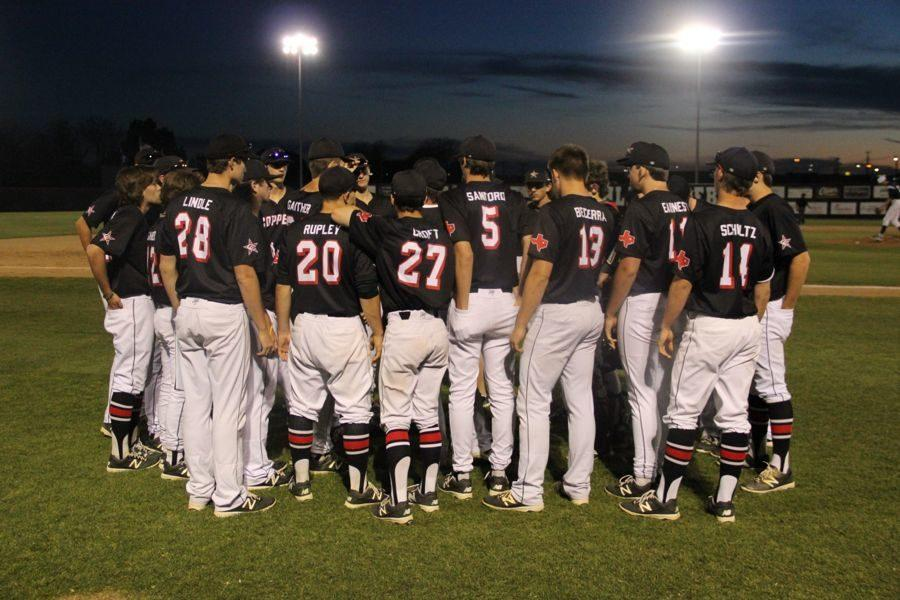 The+Coppell+High+School+varsity+baseball+team+huddles+after+its+game+against+Richland.+