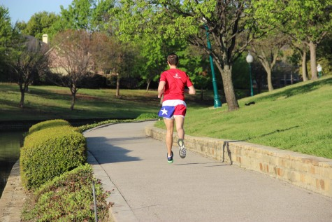"Coppell High School AP Human Geography teacher Ryan Simpson jogs his typical weekend morning training route on Saturday. To complete the ""Dopey Challenge""participants must run a 5K, 10K, half-marathon, and marathon within the span of four days. Photo by Alexandra Dalton."