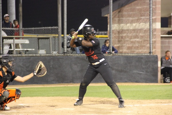 Coppell High School senior Autumn Redmon bats during Tuesday night's game against Haltom High School at the Coppell ISD Baseball/Softball Complex. The Cowgirls won at the end of the fifth inning with a score of 10-0.