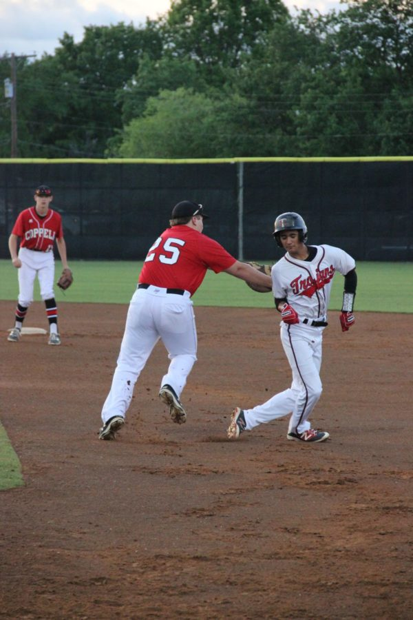 Coppell+High+School+sophomore+Jacob+Hering+chases+a+Trinity+player+to+second+base+during+the+top+of+the+first+inning.+Coppell+won+8-2+against+Trinity+on+Monday+at+Trinity+High+School.+%0A