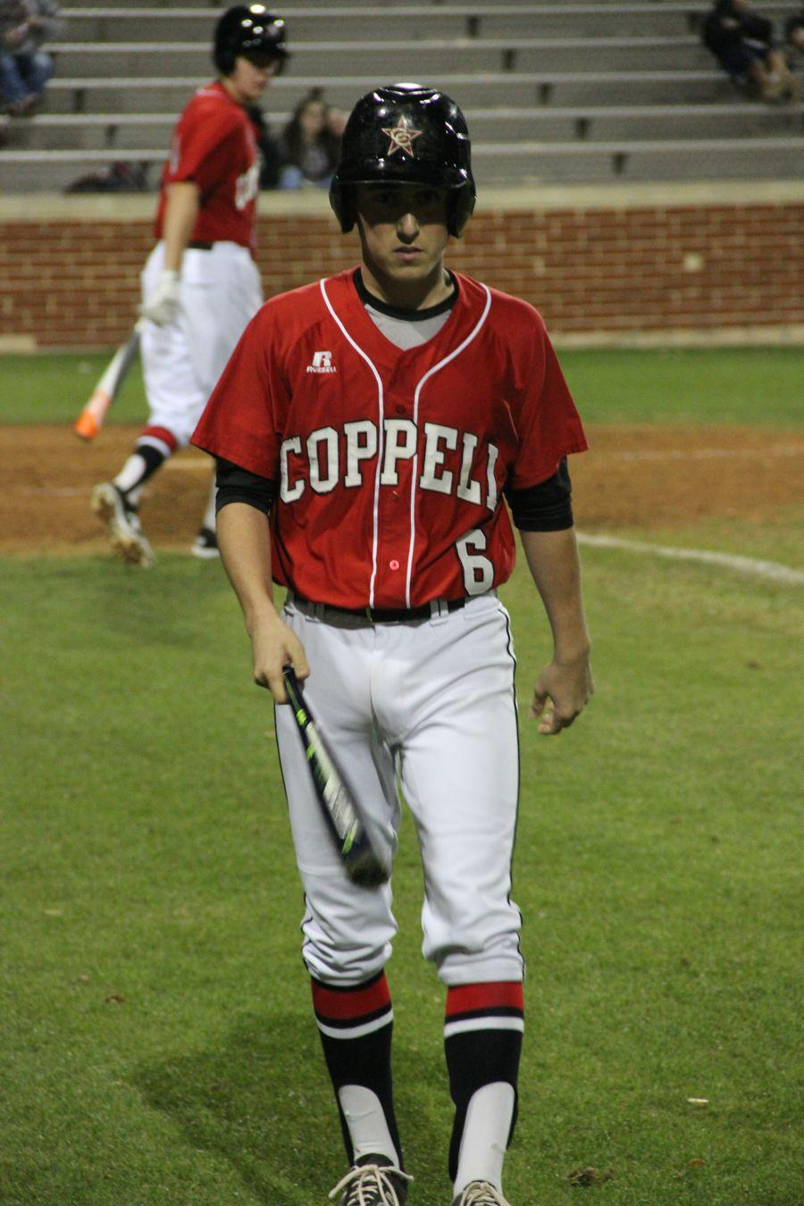Coppell+High+School+junior+Nathan+Reedy+walks+off+after+batting+during+the+game+against+Trinity.+Cowboys+beat+the+Trojans+8-2+at+Trinity+High+School.+%0A