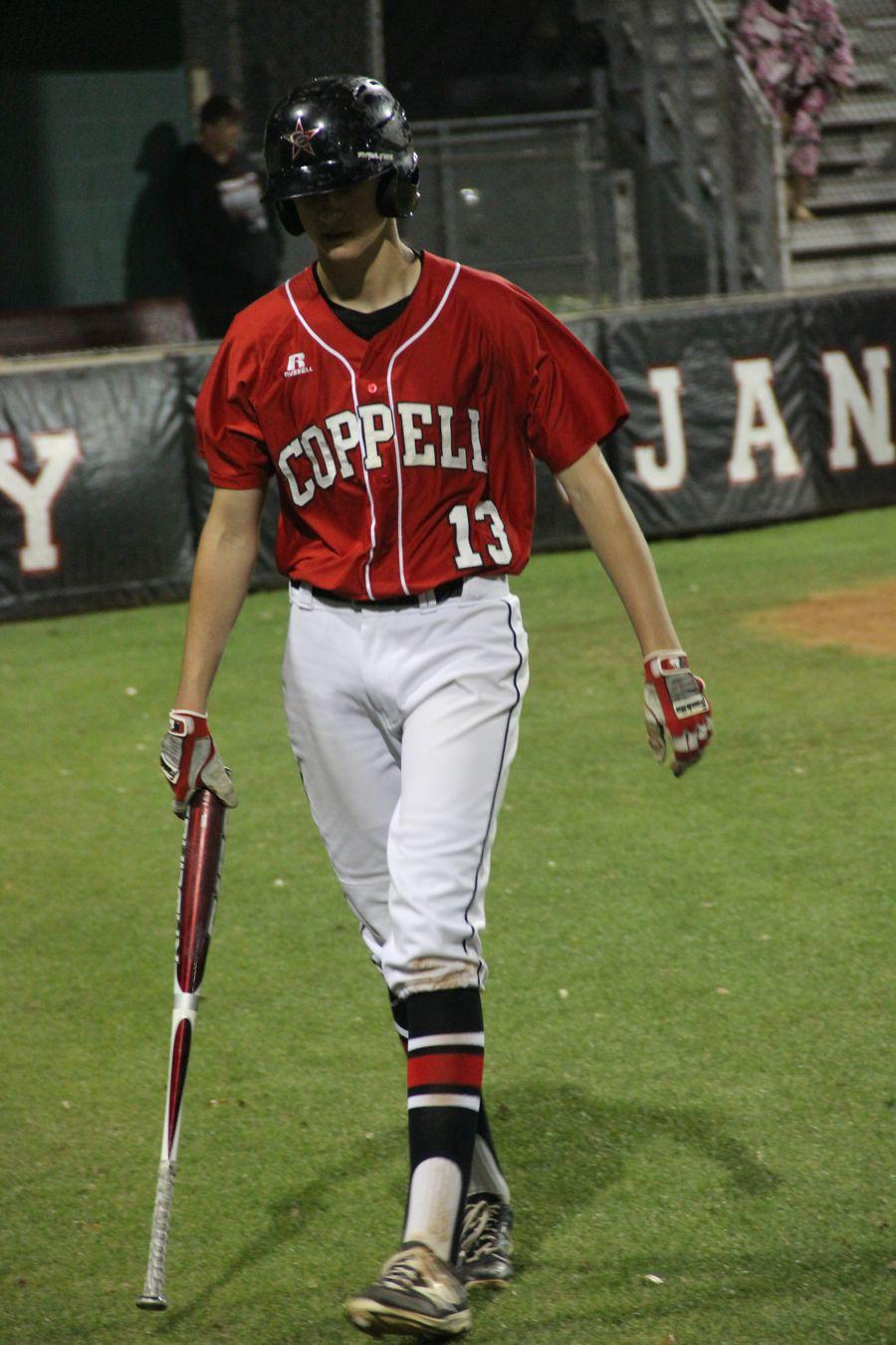 Coppell+High+School+sophomore+Rye+Gunter+walks+up+to+bat+at+the+game+against+Trinity.+Coppell+won+8-2+against+Trinity+on+Monday+at+Trinity+High+School.%0A+%0A