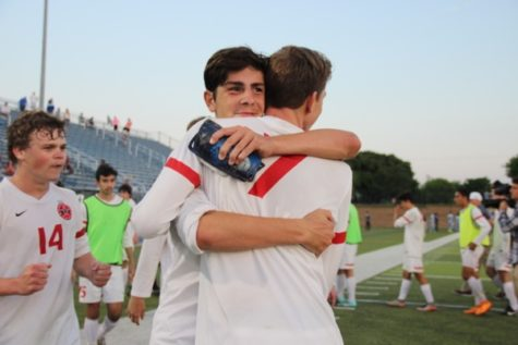 Coppell High School sophomore Wyatt Priest hugs senior Stejpan Kilic after the match on Friday at Birkelbach Field in Georgetown. The Cowboys defeated Cinco Ranch, 1-0 in the Class 6A state semifinals, and will be moving on to the state championship.