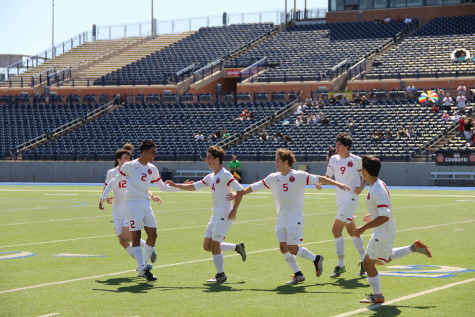 The Cowboys celebrate after sophomore forward Wyatt Priest scored on a header to put Coppell up 2-0 in the first half of the Cowboys' 2-1 win over Plano East. In the win, Coppell captures a regional championship and a berth in the state tournament on Friday, April 15.