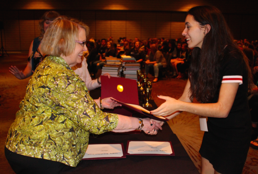 Coppell High School editor-in-chief of The Sidekick, senior Rachel Buigas-Lopez, accepts the  eighth place Best of Show for print newspaper at the JEA/NSPA Spring National High School Journalism Convention in Los Angeles on Saturday afternoon. The convention was held at the Westin Bonaventure Hotel. Photo by Aubrie Sisk.