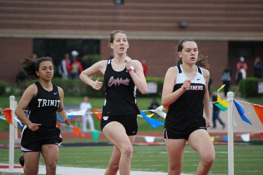 Coppell+High+School+senior+Lillie+Saunders+runs+the+women%E2%80%99s+800+meter+run+on+Tuesday+evening+at+Buddy+Echols+Field.+Coppell+JV+and+Varsity+runners+and+field+athletes+participated+in+the+District+7-6A+Track+%26+Field+Meet+on+Monday+and+Tuesday.+Photo+by+Kelly+Monaghan.