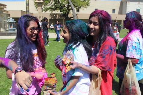 Seniors Aditi Mukund, Sneha Karkala and Veena Suthendran celebrate Holi by throwing colors on each other. Holi is celebrated with a lot of energy with colors, which represent the shades of emotions in life. Photo by Alexandra Dalton.