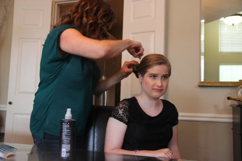 Coppell High School junior Ashton WIlliams has her hair done by her mother on Saturday in her home. Williams attended the CHS Spring Fling banquet, an evening celebrating the accomplishments of students who receive special education in the district. Photo by Mallorie Munoz