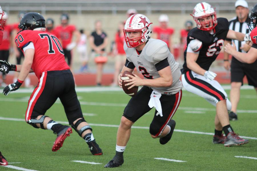 Coppell High School sophomore and quarterback Brady McBride sprints towards the end zone as the first half on tonight's spring football game comes to a close at Buddy Echols Field. The red team defeated the black team with a final score of 7-3.