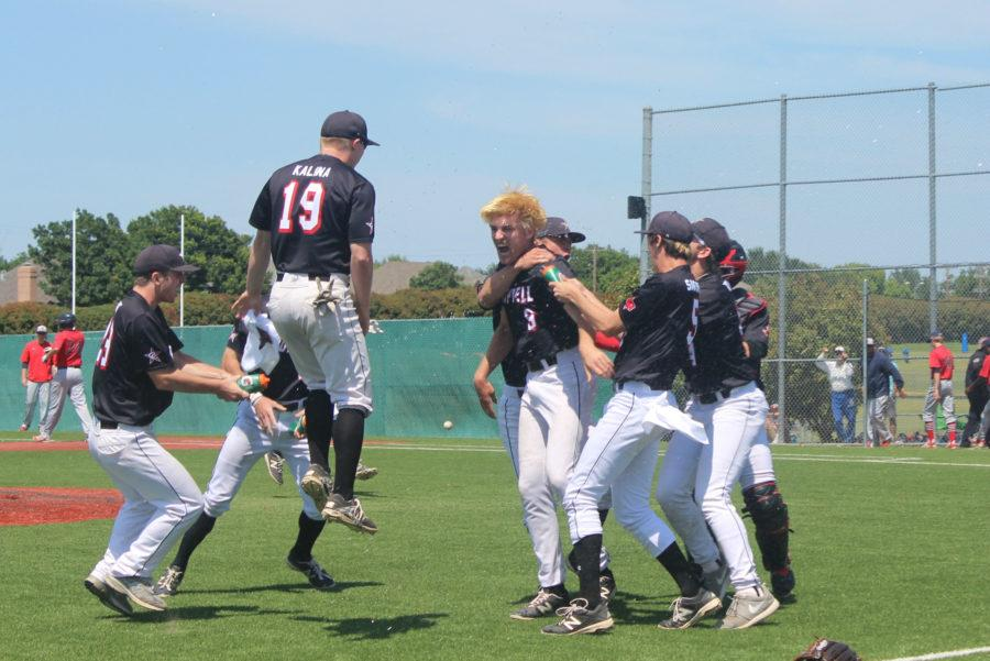Senior pitcher Charles King celebrates with teammates after King's no-hitter against McKinney Boyd in game three of the Cowboys' defeat of the Broncos. King's performance led Coppell to victory in a win-or-go-home game to put them in the regional quarterfinals.