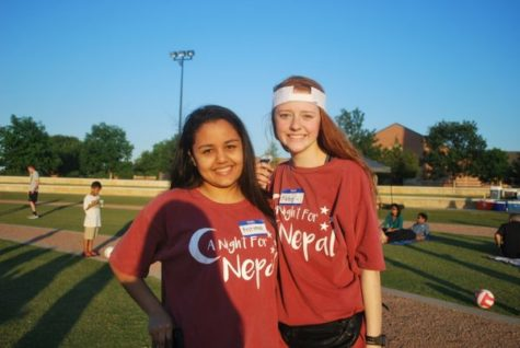 Coppell High School sophomores Kritima Lamichhane and Abby Hymer lead an event called Night for Nepal on Friday at Coppell Town Hall. Night for Nepal is an event in which high school students collected money to build a school in Nepal.