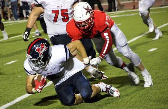 Junior outside linebacker Cody Masters tackles the McKinney Boyd running back in a game on Sept. 4. Masters finished the season with 60 total tackles. Photo by Amanda Hair.