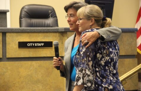 Coppell Mayor Karen Hunt hugs newly retired Community Information Officer Sharon Logan after the announcement of the day of appreciation dedicated to her.