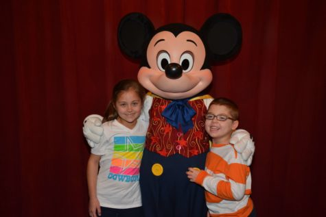Will Bubela and his sister, Paige Bubela, pose with Mickey Mouse during their Make-A-Wish trip to Disney World. Will has Dravet Syndrome, a debilitating seizure disorder that begins during infancy.