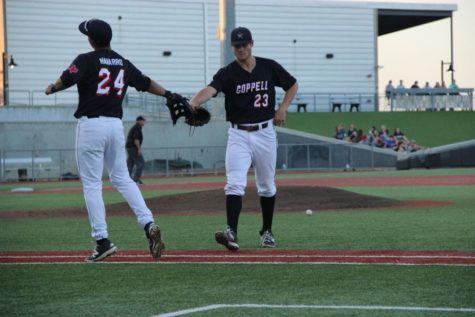 Coppell High School senior infielder Marco Navarro high fives senior pitcher Ray Gaither after recording a third inning strikeout on Friday. Cowboys beat the Jaguars 1-0 at QuickTrip Park in Grand Prairie during the Class 6A Region I quarterfinal.