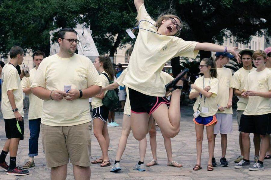 CHS Senior Meredith Munro jumps for joy at the end of a St. Ann High School Ministry retreat.  Photo courtesy Meredith Munro.
