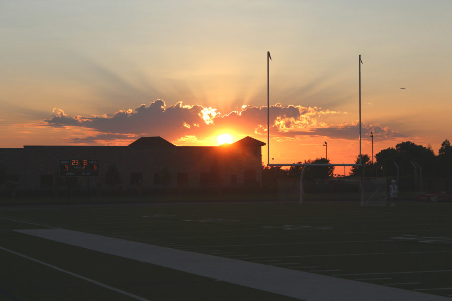 The sun sets as the Coppell girls lacrosse team was down 6-5 early in the second half. The Cowgirls ended up losing 12-11, knocking them out of the state playoffs. Photo by Joseph Krum.