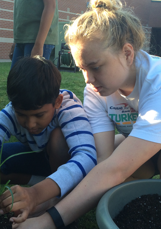 Kass helps spring blossom at Town Center Elementary with herb garden