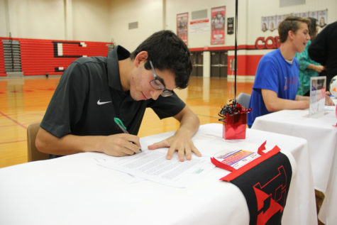Coppell soccer player Rodrigo Zuniga signs his letter of intent to play at Haverford College. Zuniga was one of six Coppell boys soccer players to sign to a college. Photo by Ale Ceniceros.