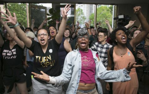 Krys Didtrey, left, and Gloria Merriweather, center, of Charlotte, N.C., lead chants in opposition to HB2 during a protest in the lobby of the State Legislative Building in Raleigh, N.C., on Monday, April 25, 2016. A large group of people starting chanting in the lobby moment after the House adjourned for the evening. (Robert Willett/Raleigh News & Observer/TNS)