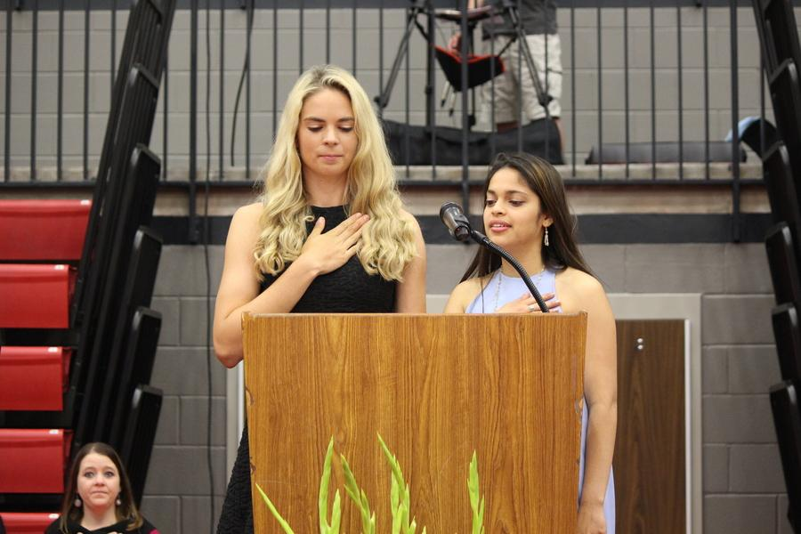 Senior class officers, President Neha Purandare and Vice President Morgan Widner, recite the pledge at the beginning of the senior awards ceremony on Wednesday morning. Seniors received awards and scholarships during the ceremony which took place in the CHS arena.
