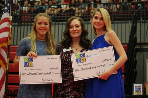 Seniors Linda Castranova and Maddy Giddens are presented with scholarships during the senior awards ceremony on Wednesday morning in the CHS arena. The senior class received over $20 million in scholarships.