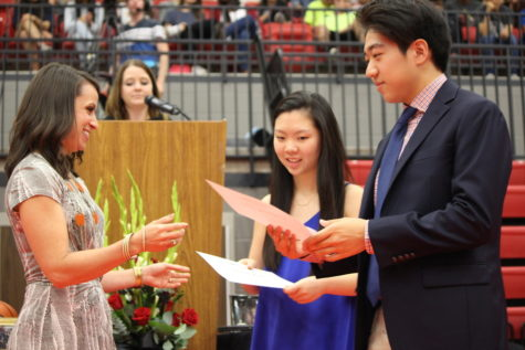 Senior class officers, Secretary Taeeun Kim and Treasurer Eugene Ha, receive scholarships during the senior awards ceremony on Wednesday morning in the CHS arena. The senior class received over $20 million in scholarships.