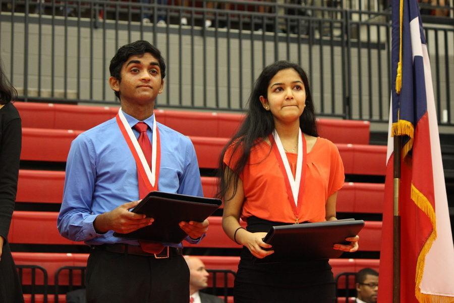 Salutatorian+Vinay+Kalvacherla+and+Valedictorian+Pooja+Marella+stand+together+after+being+awarded+medals+for+being+number+one+and+two+in+the+senior+class.+Seniors+received+awards+and+scholarships+during+the+ceremony+on+Wednesday+morning+which+took+place+in+the+CHS+arena.+Photo+by+Kelly+Monaghan.%0A