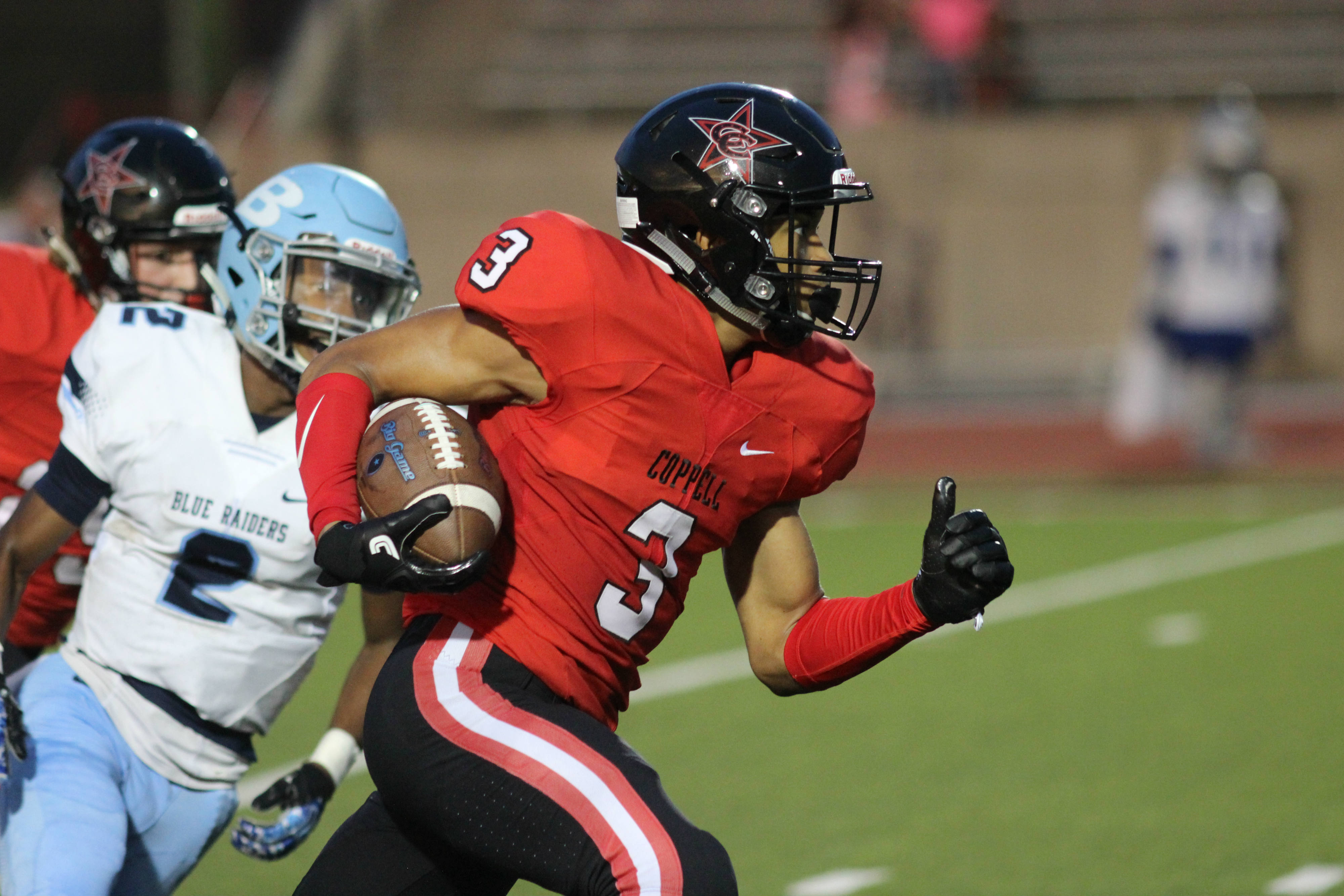 During Friday night's game, Coppell High School sophomore and free safety Jonathan McGill runs the ball down the field as the first quarter comes to a close at Buddy Echols Field. The Coppell Cowboys ended the night with a 28-21 victory over L.D. Bell. Photo by Amanda Hair.