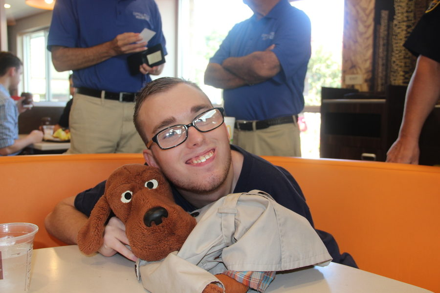 Twenty-one-year-old Stuart Paduano poses for a photo with his best friend, McGruff the Crime Dog, at Coppells biannual Coffee With Cops on Saturday.