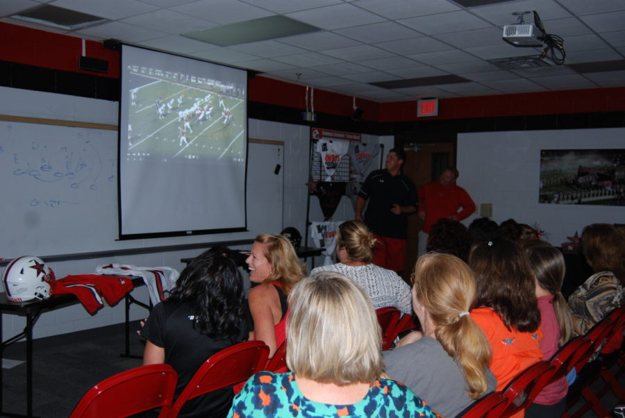 Football+101+attendees+share+a+laugh+as+offensive+coordinator+Jay+Jones+explains+a+play+that+the+Cowboys+ran+last+year.+In+total%2C+there+was+over+100+attendees.+Photo+by+Meara+Isenberg.