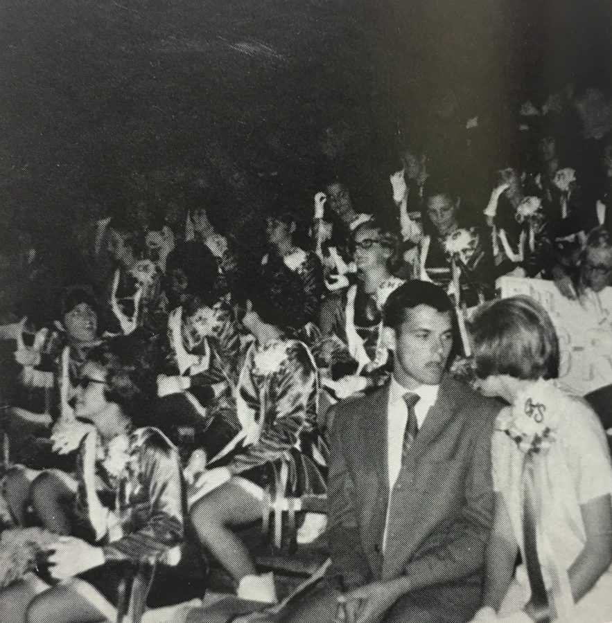 Coppell High School homecoming queen, Rory, chats with a friend in her bitesized mum at the homecoming game. Mums were attached to girls shirts with pins throughout the day during the 1970 festivities. Photo curtesy of Coppell Yearbook.