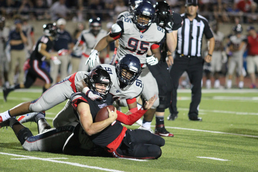 Coppell+High+School+junior+quarterback+Brady+Mcbride+is+tackled+by+Allen+defensive+linemen%2C+Jayden+Jernigan+and+Will+Udo%2C+during+the+fourth+quarter+of+Friday+night%E2%80%99s+game+to+the+Allen+Eagles+at+Buddy+Echols+Field.+Coppell+had+an+early+10-7+lead+in+the+first+quarter%2C+but+couldn%E2%80%99t+sustain+it+as+the+Eagles+pulled+off+a+42-20+win+over+the+Cowboys.+