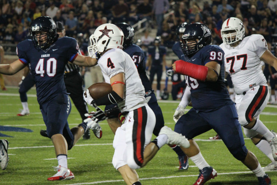 Coppell senior running back Gavin McDaniel tries do elude Allen defenders in the Cowboys' 31-10 loss in Allen. The last time the Eagles came to Buddy Echols, however, the Cowboys pulled off a 27-24 upset victory.