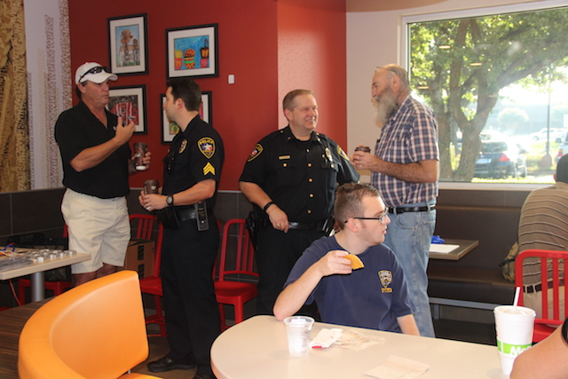 """Sakshi Venkatraman A group of Coppell police officers converse with attendees of the """"Coffee With Cops"""" event on Saturday morning at McDonald's. After five members of the Dallas Police Department were shot in July, many Coppell citizens wanted to show their continued support for the Coppell Police Department."""