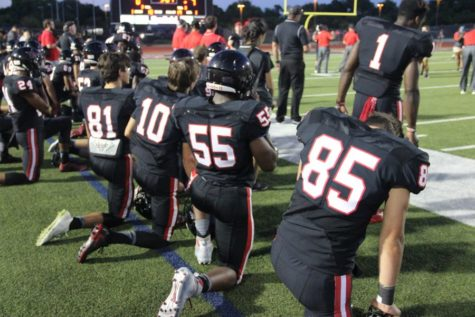 Coppell High School varsity football players kneel while Coppell player Skyler Siedman is injured on the field during Friday night's game. Allen claimed a victory over Coppell with a final score of 42-20 at Buddy Echols Field.