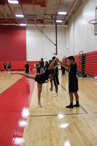 As Coppell High School sophomores Jalyn Ramirez and Angel Valadez wait for Julie Starlow and Hayley Mitchell to practice with them, last Wednesday. They are practicing their duet in their Dance I class.