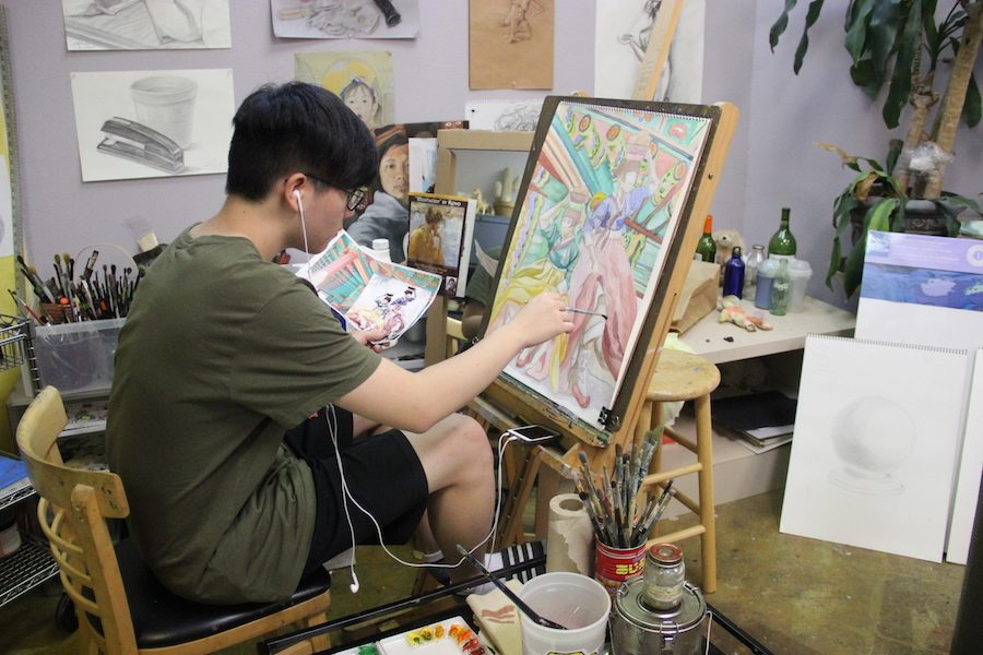 Coppell High School senior Chulmin Han carefully finishes one of his 17 art pieces on Friday at the Top Art Studio in Carrollton. He will then turn in his completed art pieces to apply to his dream art school-Rhode Island School of Design.