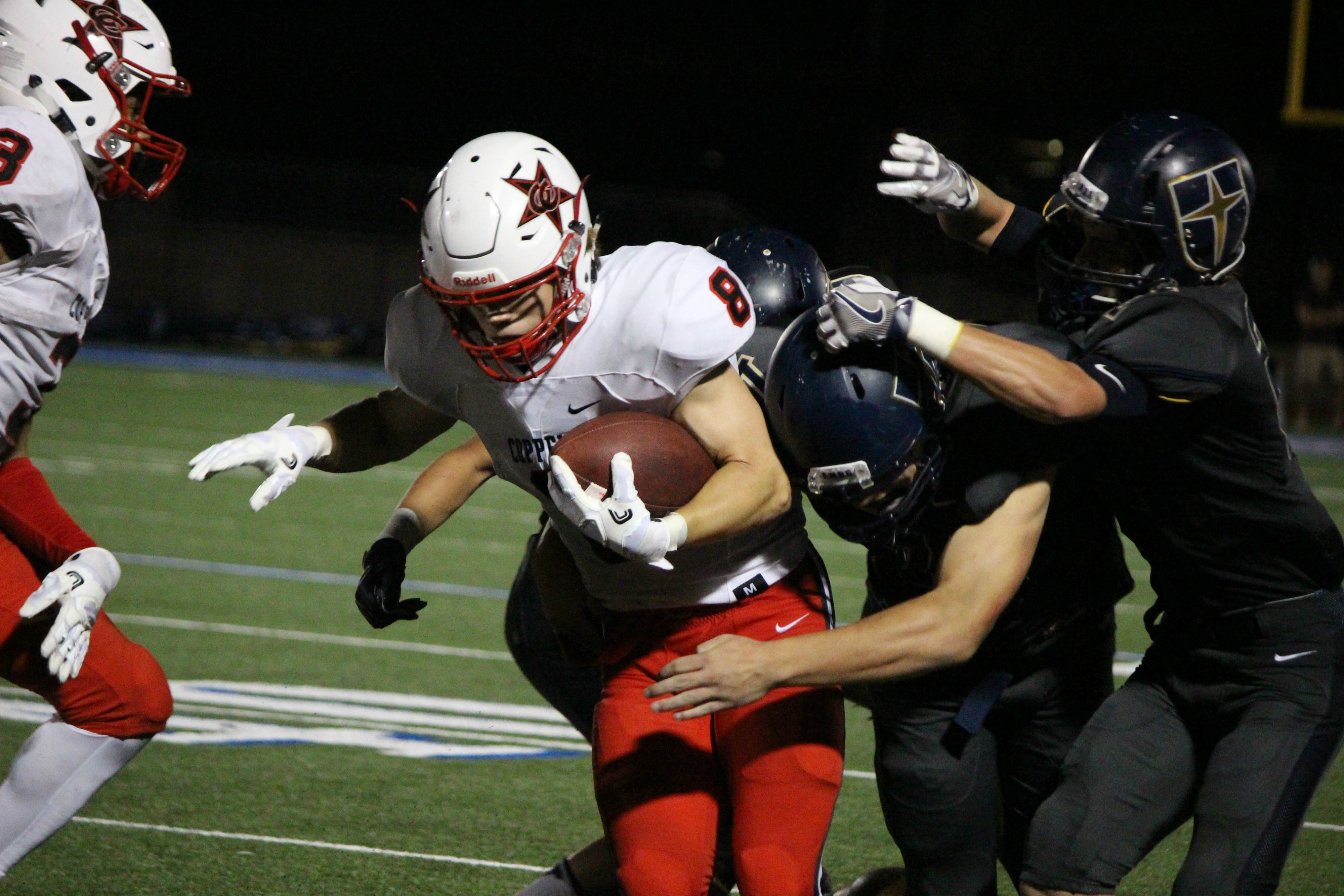 Sophomore wide receiver Blake Jackson is taken down by several Jesuit defenders in the Cowboys 41-10 loss at Jesuit on Friday. Jackson finished with six receptions for 72 yards in the loss.
