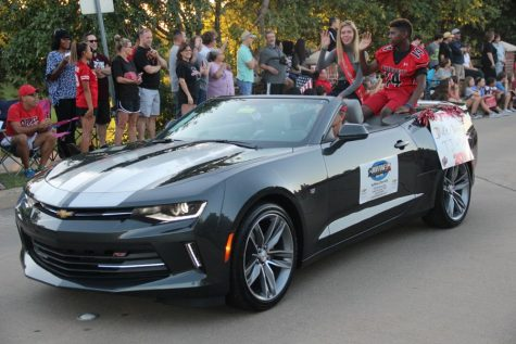 Coppell High School junior homecoming nominees Margaret Lazaroski and TJ Andres drive through the parade on Wednesday to represent the 11th grade homecoming court. All CHS students are asked to participate in the voting of the homecoming court elections.