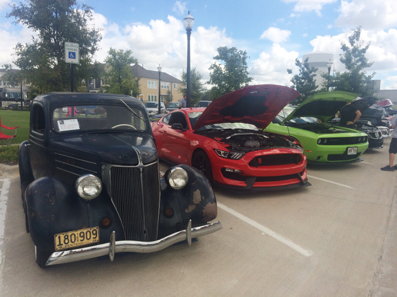 Vintage cars sit on display for visitors on Saturday at the Keller Williams Coppell Car Show. The annual event held at the Old Town Coppell square, features various classic automobiles that have been restored.
