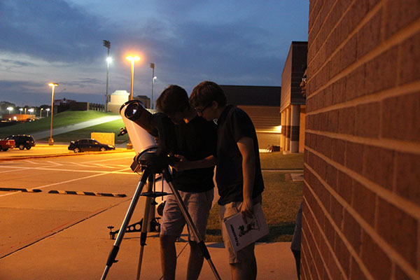 Coppell High School students look through  the telescope the science department has named 'the Beast' on Sept 21 in the CHS parking lot. Astronomy students taught AP Earth and Science students along with AP Environmental Science classess about different topics relating to the celestial sphere at Mrs. Barnes' Star Party.